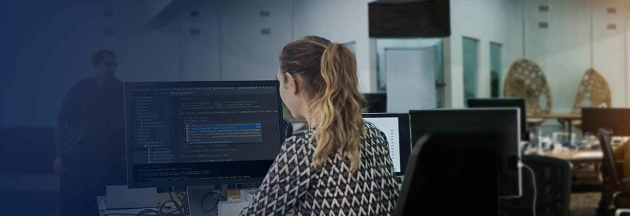 An emplyee working at her computer.