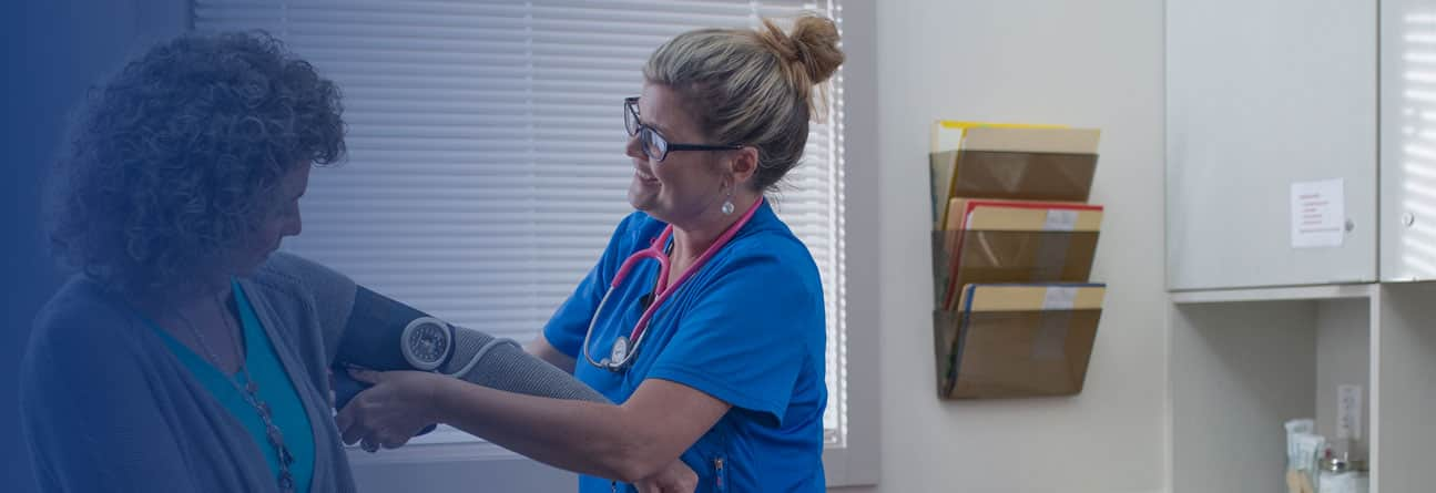 Nursing professional reviewing a file