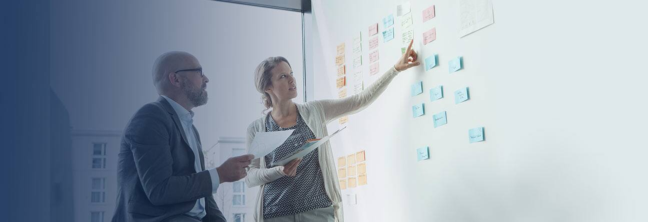 Project Managers using a planning board